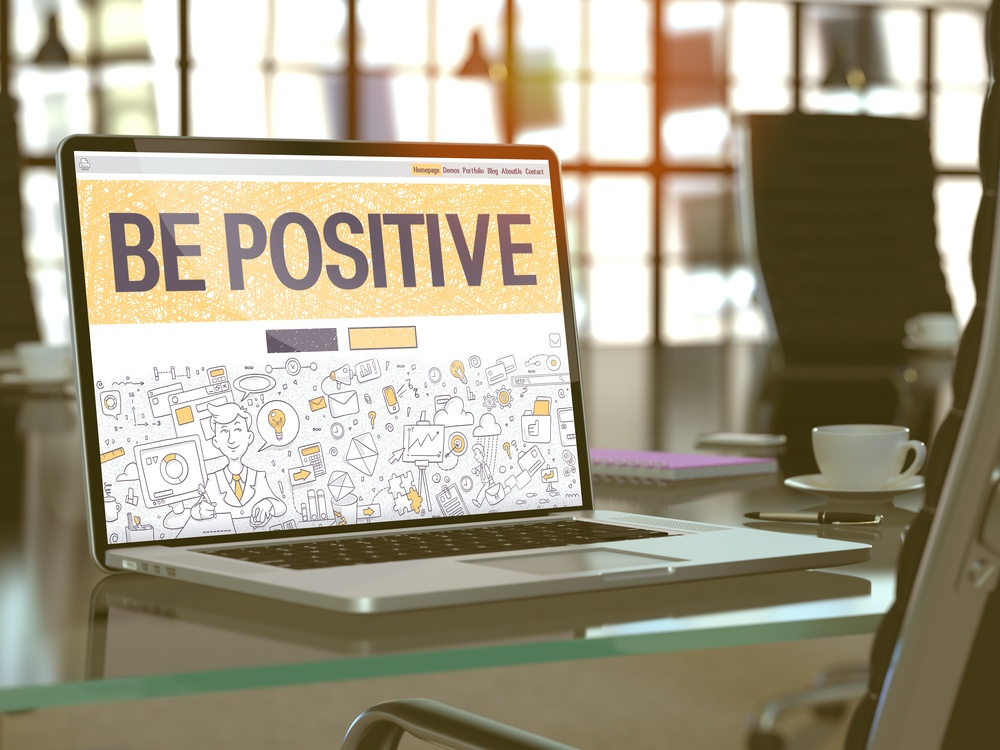 Be Positive Concept. Closeup Landing Page on Laptop Screen in Doodle Design Style. On background of Comfortable Working Place in Modern Office. Blurred, Toned Image. 3d Render..jpeg
